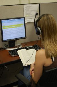 Photo: Student using e-text for reading