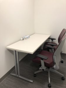 Individual testing room with table and 2 chairs